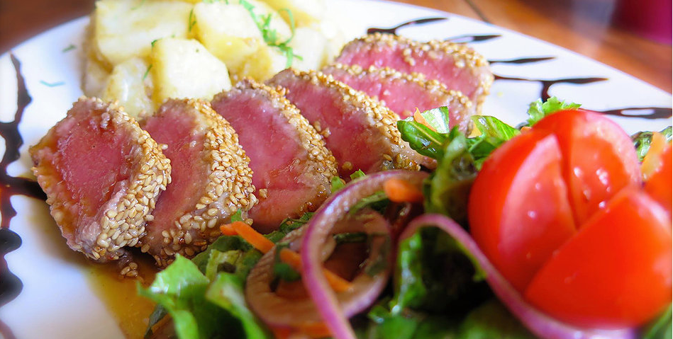 tuna on plate with salad and potatoes