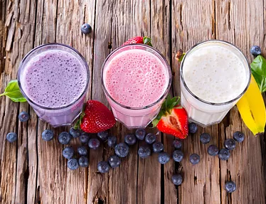 three smoothies, blueberry, strawberry and banana
