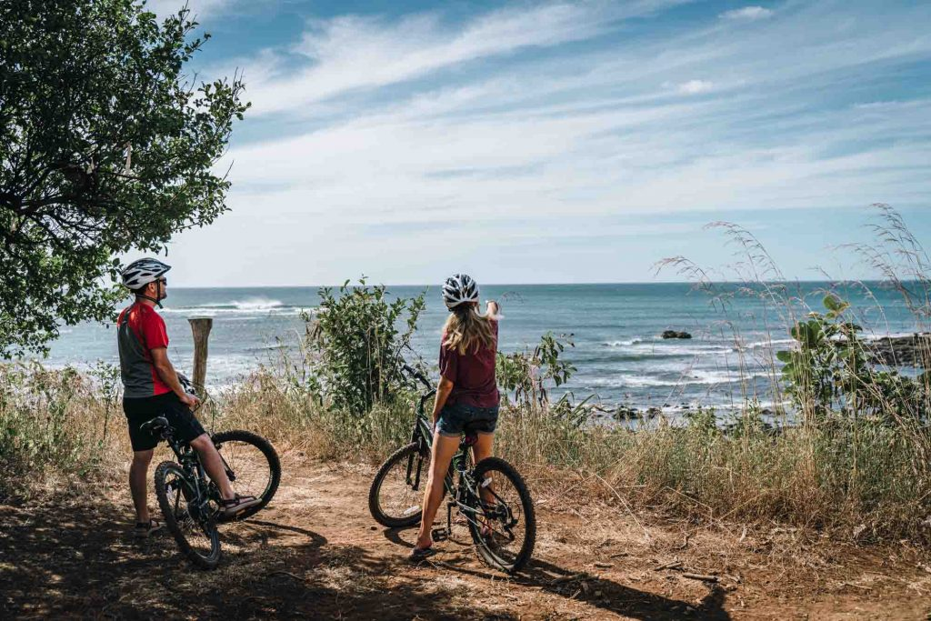 two people on bicycle looking at Costa Rica beach