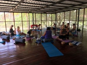 Wellness group in the yoga studio at Drift Away Eco-Lodge